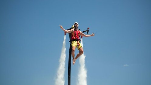 A man enjoying the thrill of flying with a Jetpack backpack in Sydney