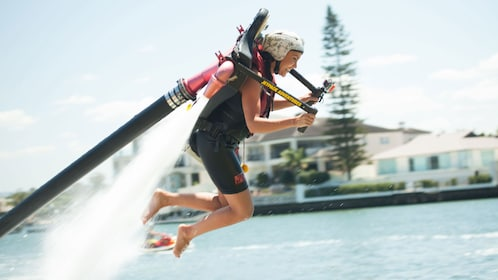 Woman having fun with hydro jetpack in Sydney