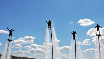 Show item 1 of 6. Group of four enjoying flying in the water with Jetpacks and flyboards in Australia