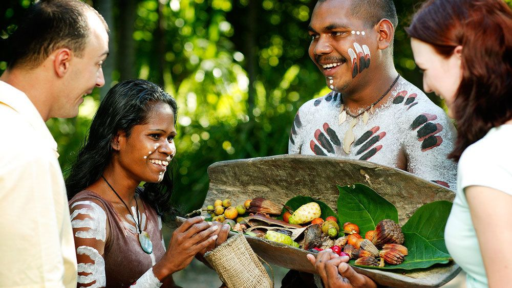 Guests are offered fruits at the Tjapukai Aboriginal Cultural Park in Cairns during their visit