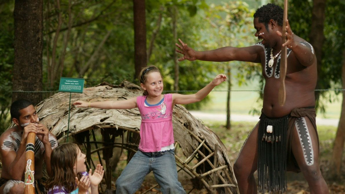 kids learning from the tour guides at the Tjapukai Aboriginal Cultural Park in Cairns