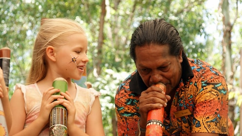 Girl having an interactive experience at the Tjapukai Aboriginal Cultural Park in Cairns