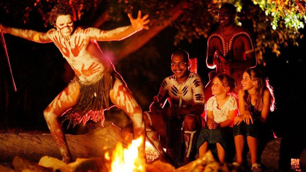 Show item 1 of 5. Guests enjoying a live dance performance at the Tjapukai Aboriginal Cultural Park Night tour