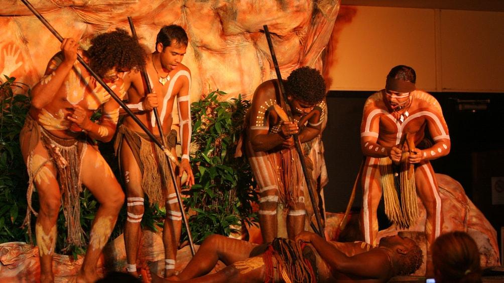 Show item 2 of 5. Close view of dancers performing at the Tjapukai Aboriginal Cultural Park night tour