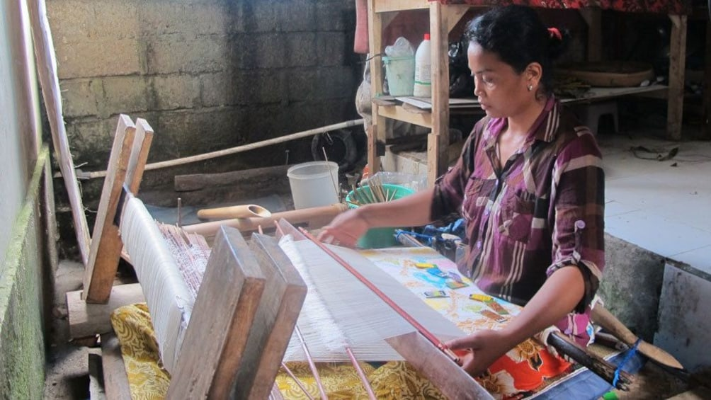 A woman at a loom in Bali