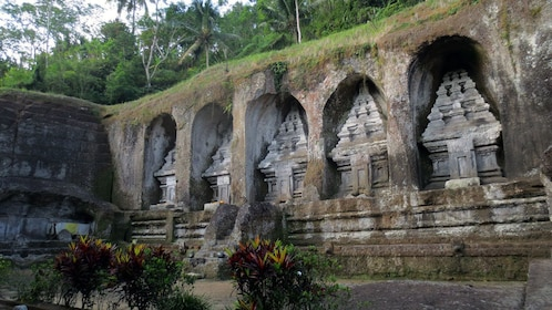Sculptures carved into a wall of a temple in Bali
