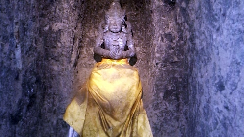 Yellow skirted stone carved statue in Bali