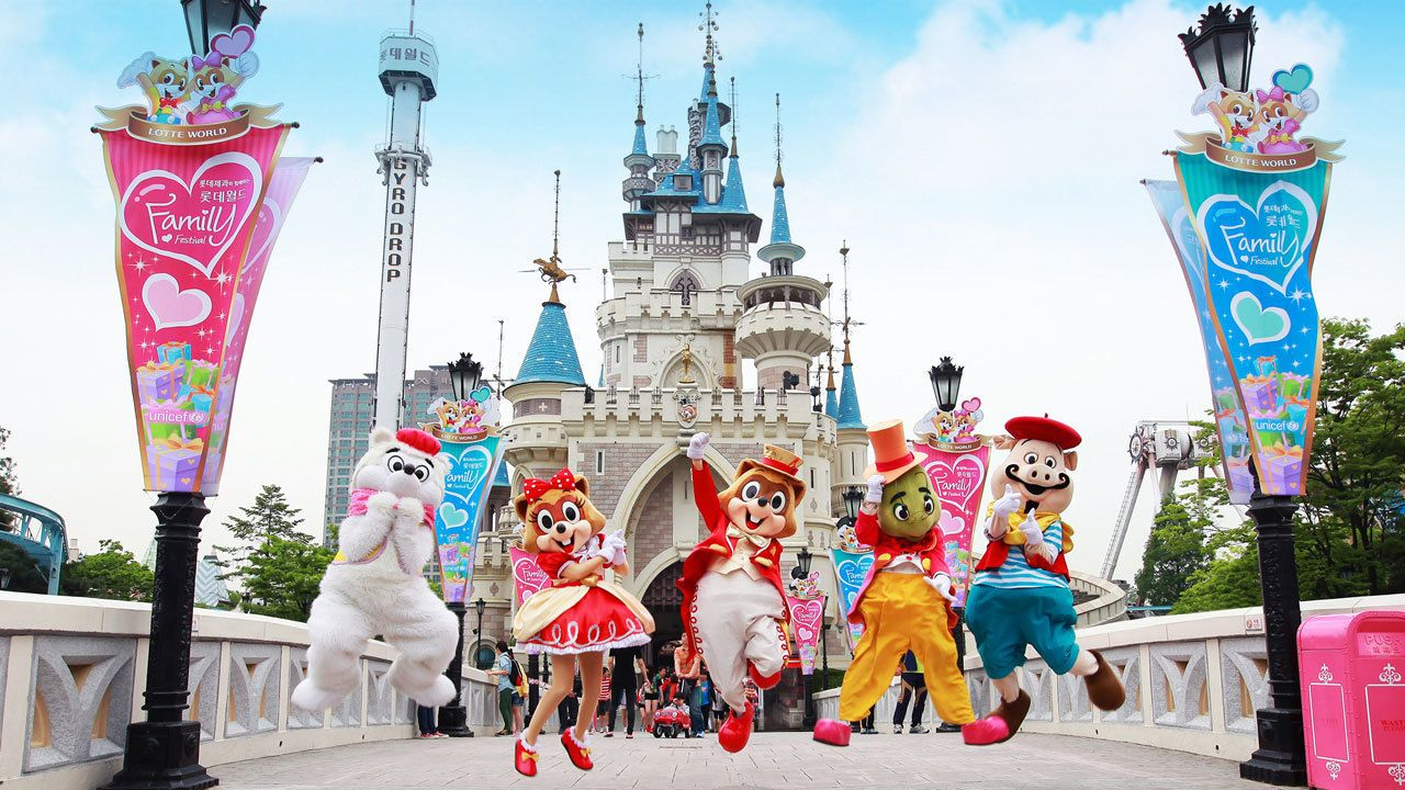 Characters jumping in front of a castle at Lotte World Theme Park in Seoul