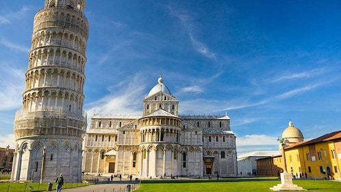 Ornate building and leaning tower of Pisa Italy