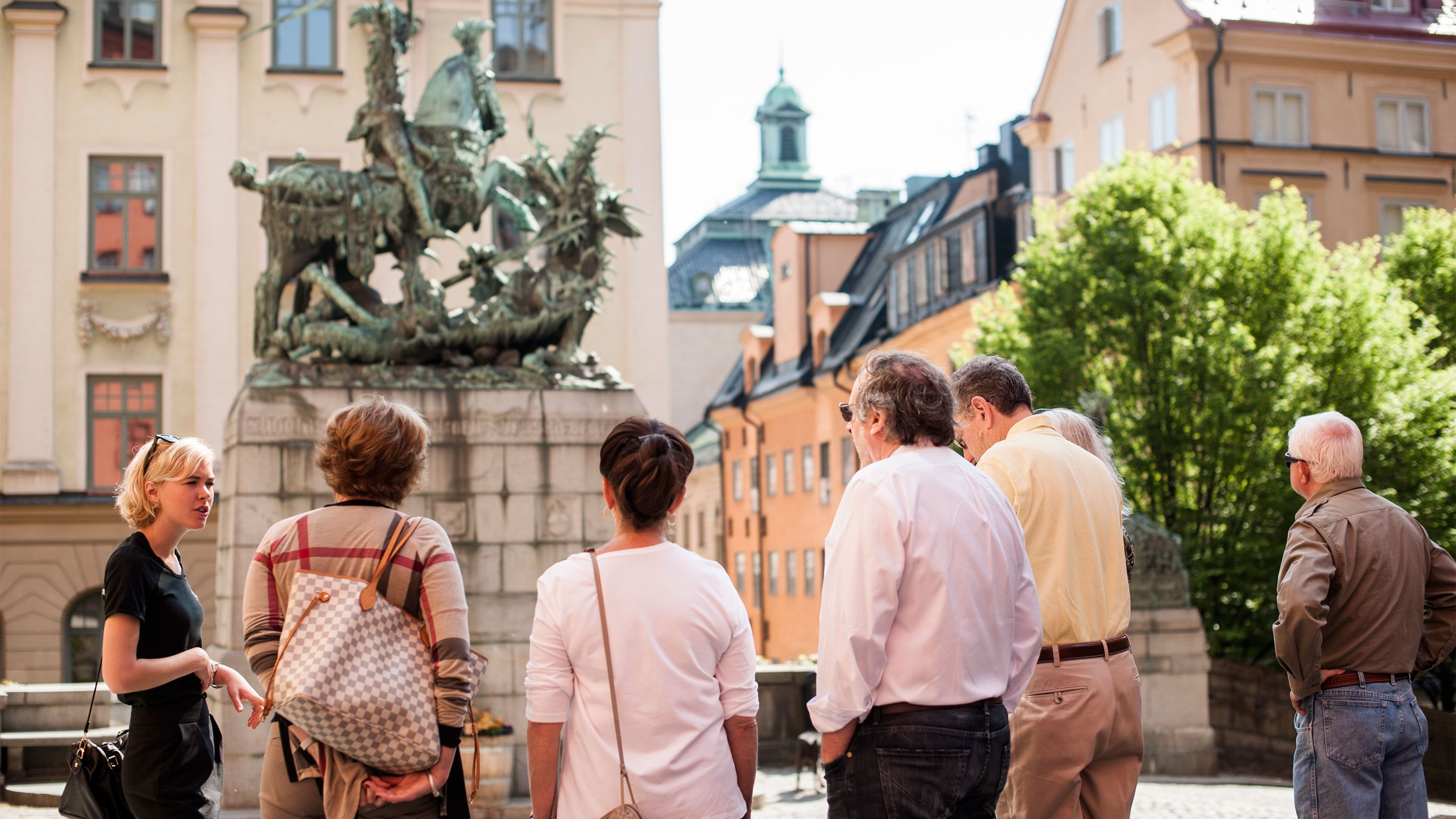 People admiring a statue in Stockholm