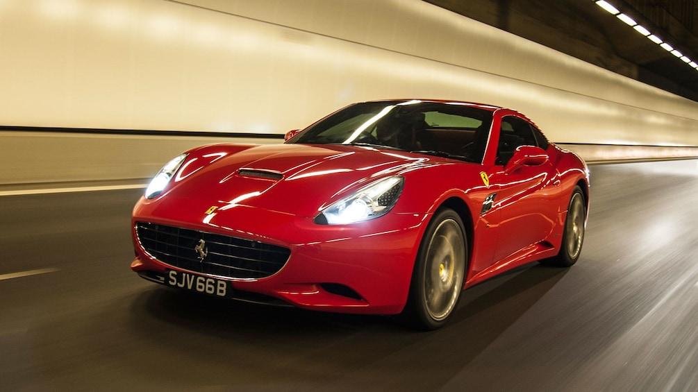 Show item 2 of 10. Red Ferrari in a tunnel