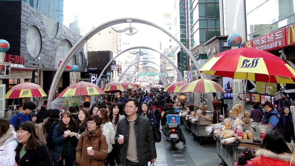 Show item 2 of 5. Crowded street in Busan during the day