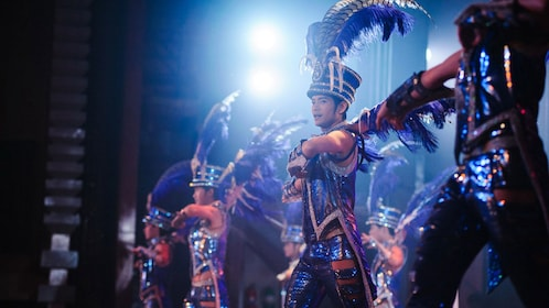 Men in costume performing on stage in Pattaya