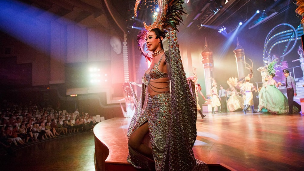Show item 5 of 5. Dancer walking towards the audience during a show in Pattaya