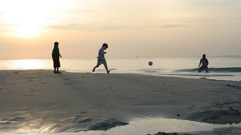 Show item 5 of 5. Children playing ball at the Samet Island in Pattaya