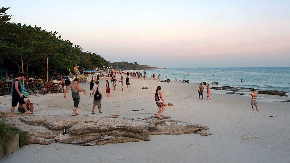 Show item 1 of 5. Beach goers enjoying the sunset in Pattaya