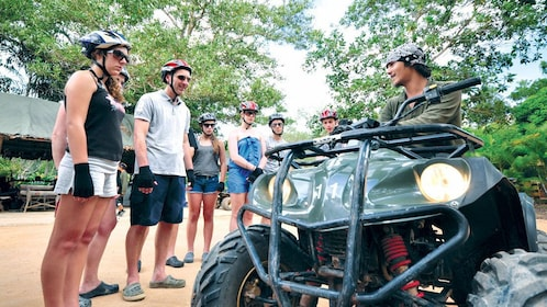 Instructor teaching a group how to ride an ATV in Phuket.