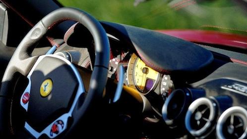 Steering wheel and dashboard inside a Ferrari in Monaco