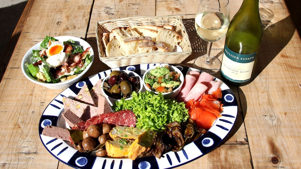 Show item 3 of 7. Food platter with wine during tour in Wellington