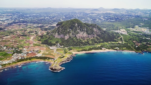 Aerial view of a mountain and towns in Jeju