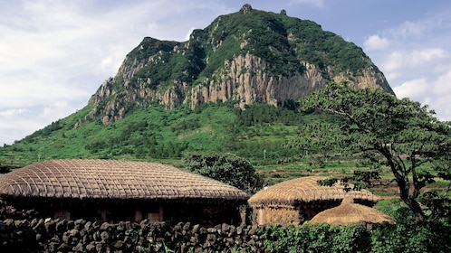View of traditional homes in a village at the foot of a mountain in Jeju