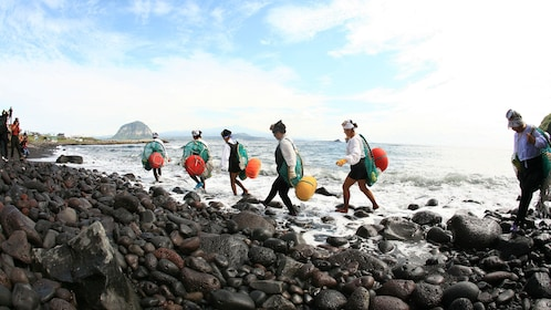 Fishermen carrying their supplies from the water in jeju
