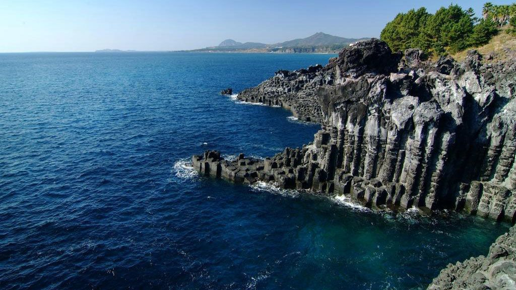 View of rocky cliffs on the coast of Jeju