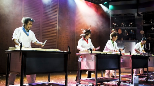 Performers dressed as chef chopping in rhythm on stage during Nanta Show on Jeju Island