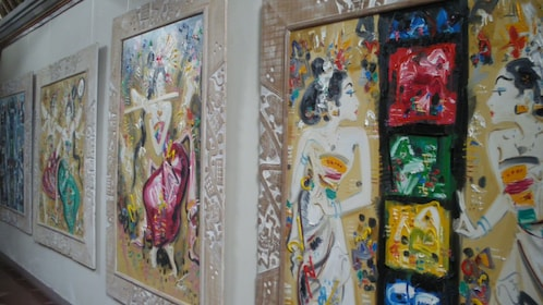 paintings on display at a gallery in Bali