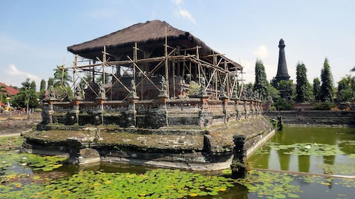 A temple pagoda surrounded by water in Bali