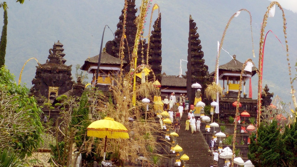 People walking down the stairs to a temple in Bali