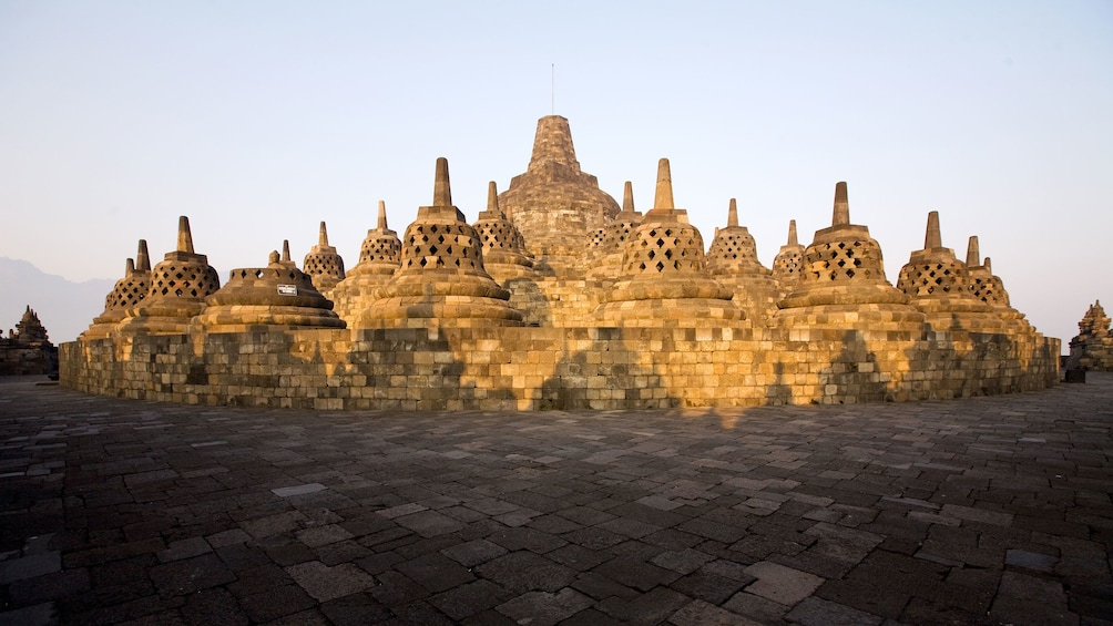 Bell-shaped stupas with a larger stupa in the center at Borobudur Temple in Yogyakarta