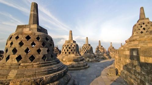 Large bell-shaped stupas at Borobudur Temple in Yogyakarta