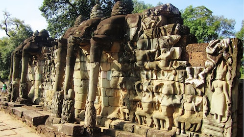 carved stone wall near siem reap
