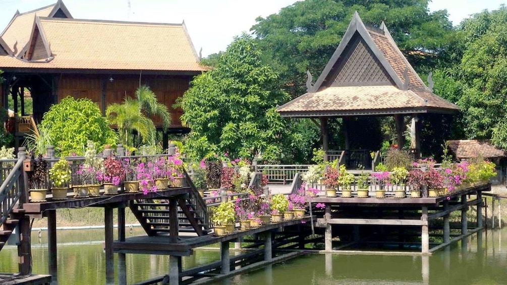 dock with purple flowers near Siem Reap
