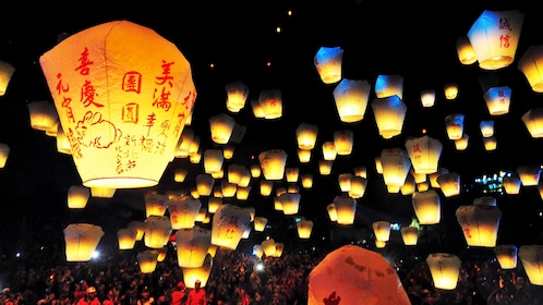 Gorgeous night paper lanterns flying in the sky in Taipei