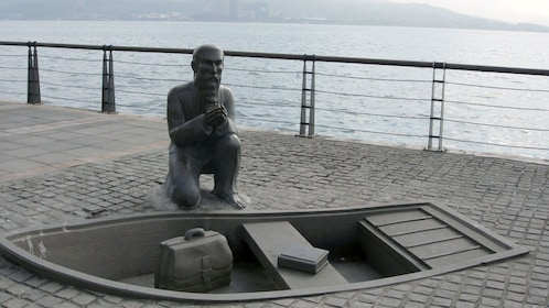 Statue of a person and boat on a deck in Taipei