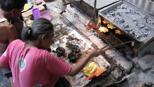 Woman baking pastries in Kotagede