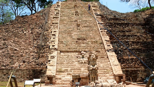 Person on stairs on temple in Copán ruins