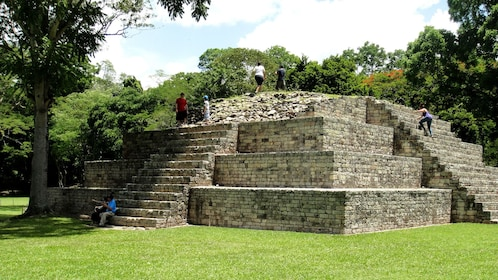 Tourists on ruins in Copán