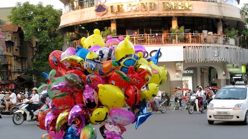balloon vendor out on the road in Hanoi