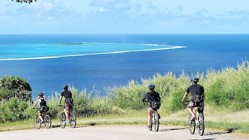 Group on a Downhill Bike Adventure during the day in Saipan overlooking the beautiful blue waters