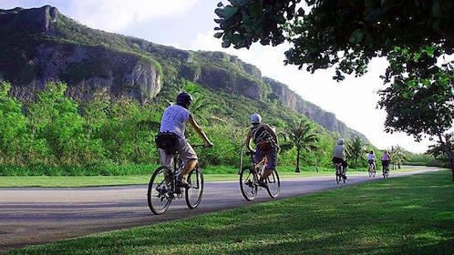 Group biking up a hill on a beautiful day in Saipan
