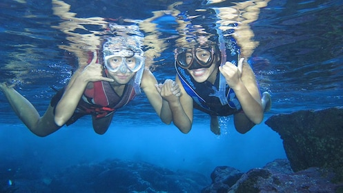 Tourists snorkeling in Grotto in Saipan