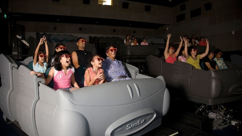 Kids in the 4D movie ride at 4D adventure land in Singapore