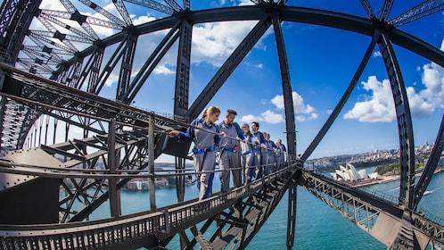 Group of tourists enjoy the famous BridgeClimb in Sydney