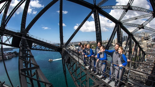 Group of tourists enjoy the view during the famous BridgeClimb in Sydney