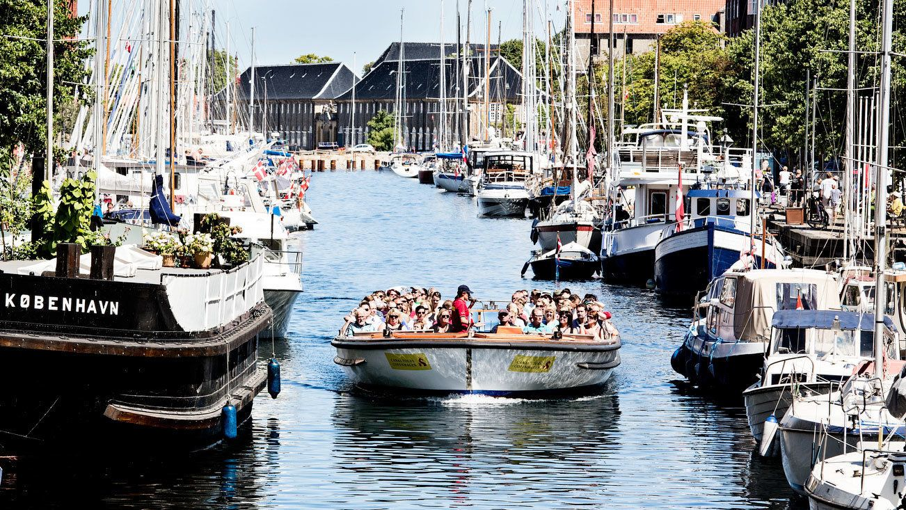 Boat of passengers traveling in the canal in Copenhagen