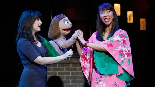 Puppet and actress in a scene from Avenue Q off broadway in New York