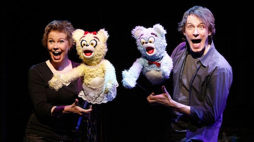 Avenue Q off broadway scene with actors and puppets in New York